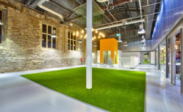 Photo of an event space at Engine Shed called Platform 14 with open space and an astroturf lawn