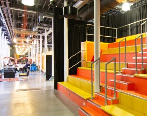 Photo showing an event space at Engine Shed called The Junction with banquet steps and a stage